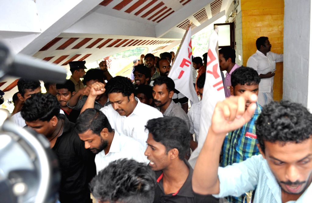 Alappuzha : People protest the death of a student, Aparna (15) at SAI`s water sports centre in Alappuzha on May 7, 2015. Aparna and 3 other SAI students admitted in to hospital after they consumed ...