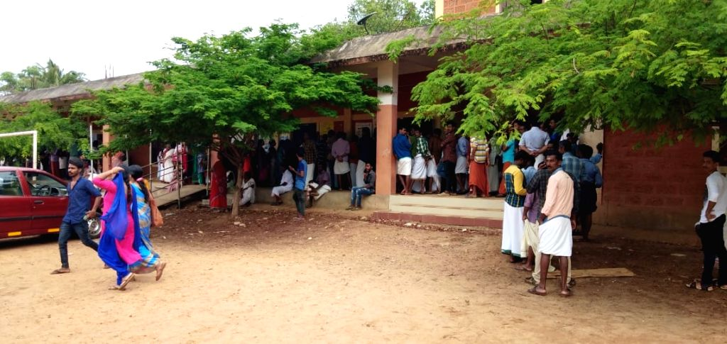 Alappuzha: People wait in a queue to cast their vote at a polling station Costal Area in Alappuzha, Kerala on APril 23, 2019. (Photo: IANS)
