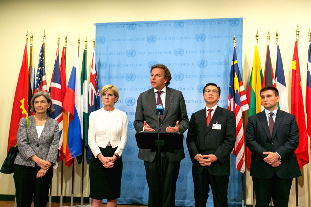 Albert Koenders(C), minister of Foreign Affairs of Netherlands, speaks to media at the United Nations headquarters in New York, July 29, 2015. Russia on Wednesday ...