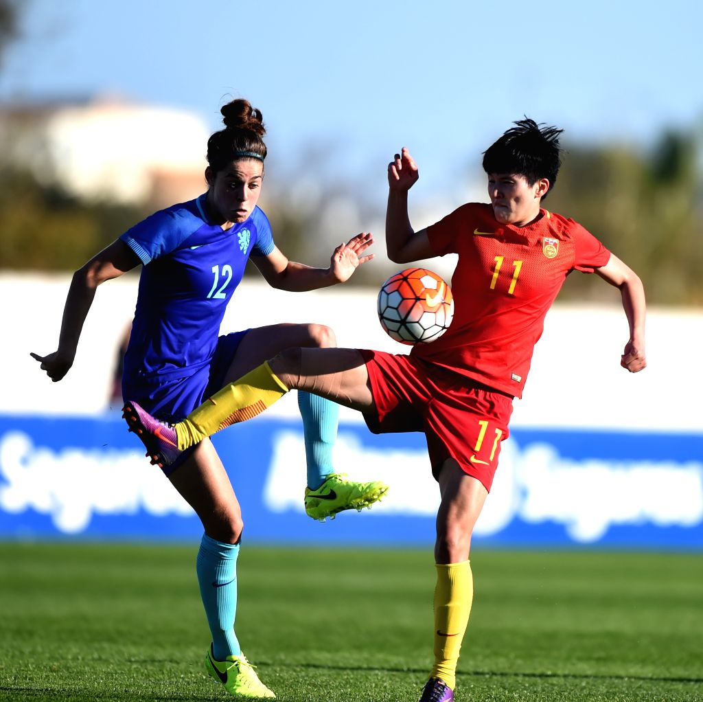 ALBUFEIRA, March 2, 2017 - China's Wang Shanshan (R) vies with the Netherlands' Tessel Middag during a Group C match at the 2017 Algarve Cup women's football tournament in Albufeira, Portugal, March ...