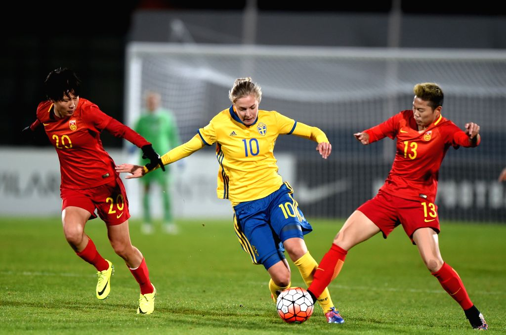 ALBUFEIRA, March 4, 2017 - Li Ying (R) and Zhang Rui (L) of China vies with Lina Hurtig of Sweden during a Group C match at the 2017 Algarve Cup women's football tournament in Albufeira, Portugal, ...