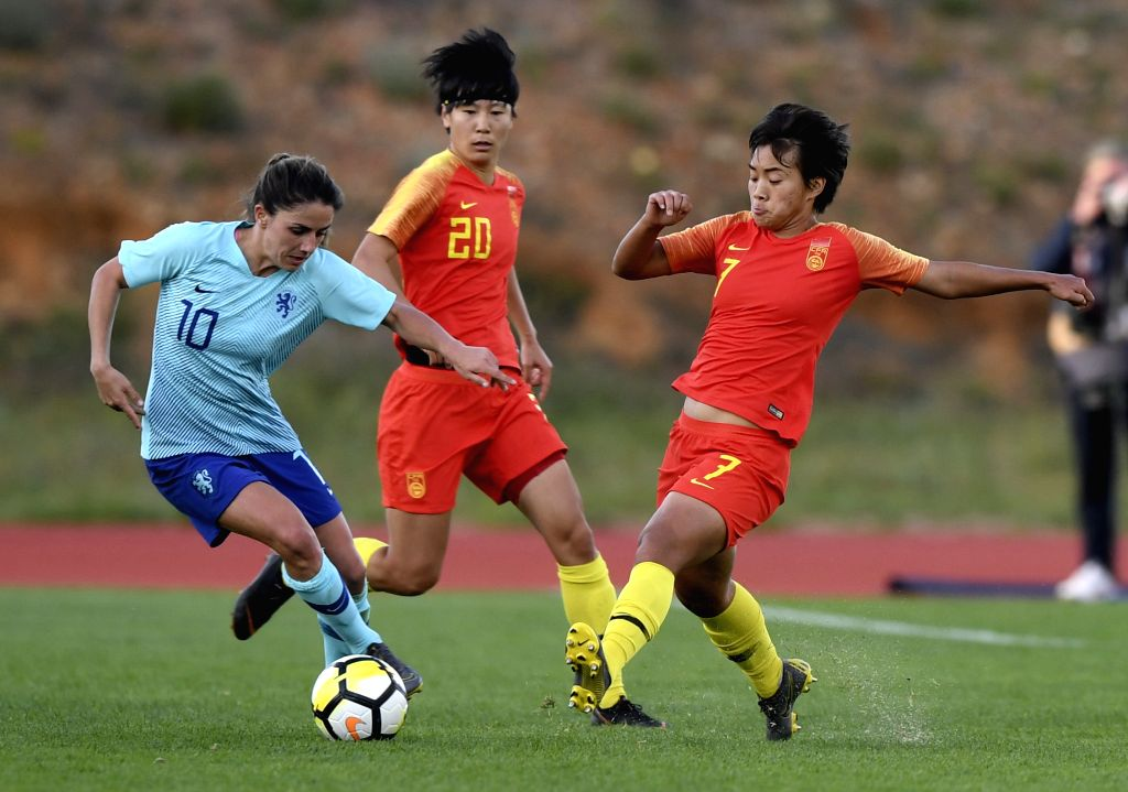 ALBUFEIRA, March 7, 2019 - China's Wang Shuang (R) vies with Danielle Van De Donk (L) of the Netherlands during the placement match 11-12 at the 2019 Algarve Cup women's football tournament in ...