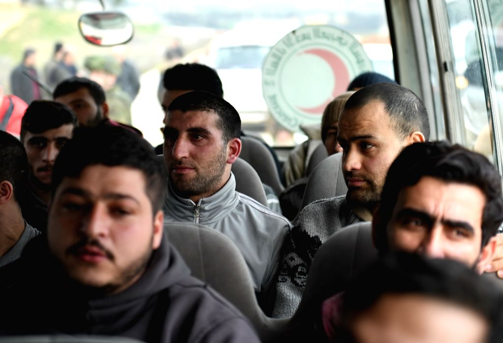 ALEPPO, Feb. 13, 2019 - Released kidnapped Syrians are seen in a Syrian Arab Red Crescent (SARC) vehicle in the countryside of Aleppo province in northern Syria on Feb.12, 2019. The Syrian army on ...