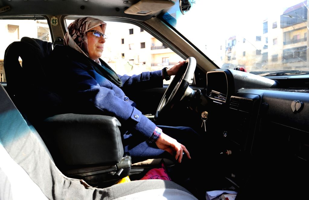 ALEPPO, Feb. 15, 2018 - Um al-Noor, a Syrian woman, drives her taxicab in Aleppo city, northern Syria, on Feb. 6, 2018. Um al-Noor, the first female taxi driver in Syria's Aleppo, shows self-reliance ...