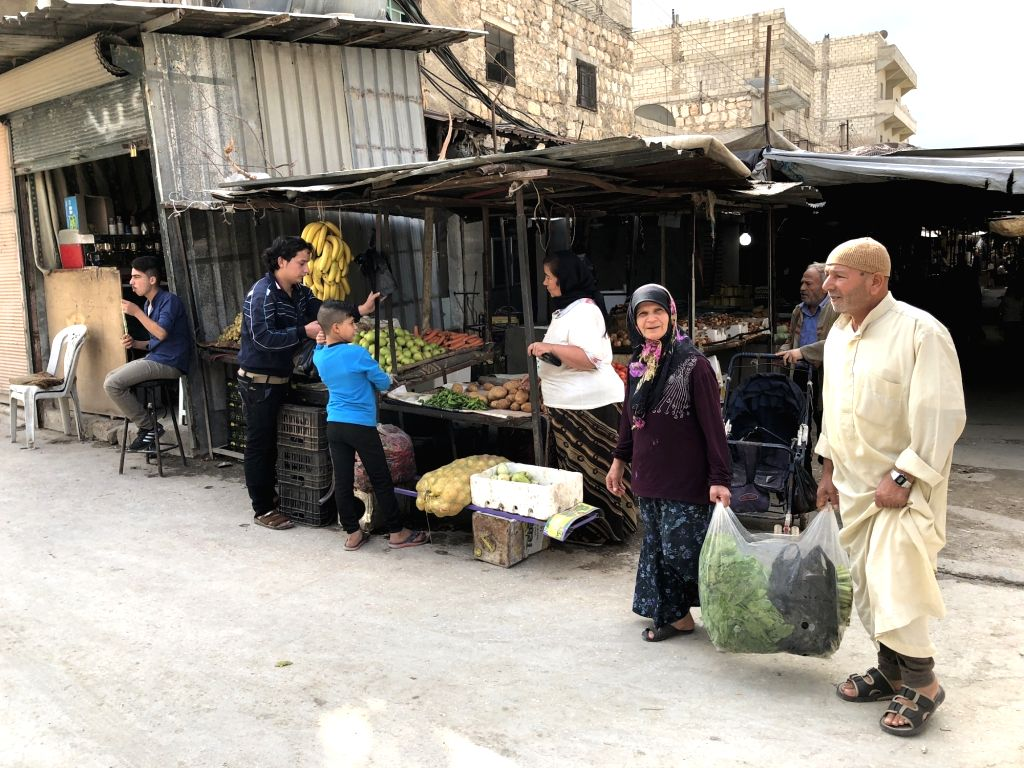 ALEPPO, Oct. 13 Photo taken on Oct. 11, 2017 shows a market in the Kurdish-controlled neighborhood of Sheikh Maksood in Aleppo city in northern Syria. Syria's Kurds try to promote ...