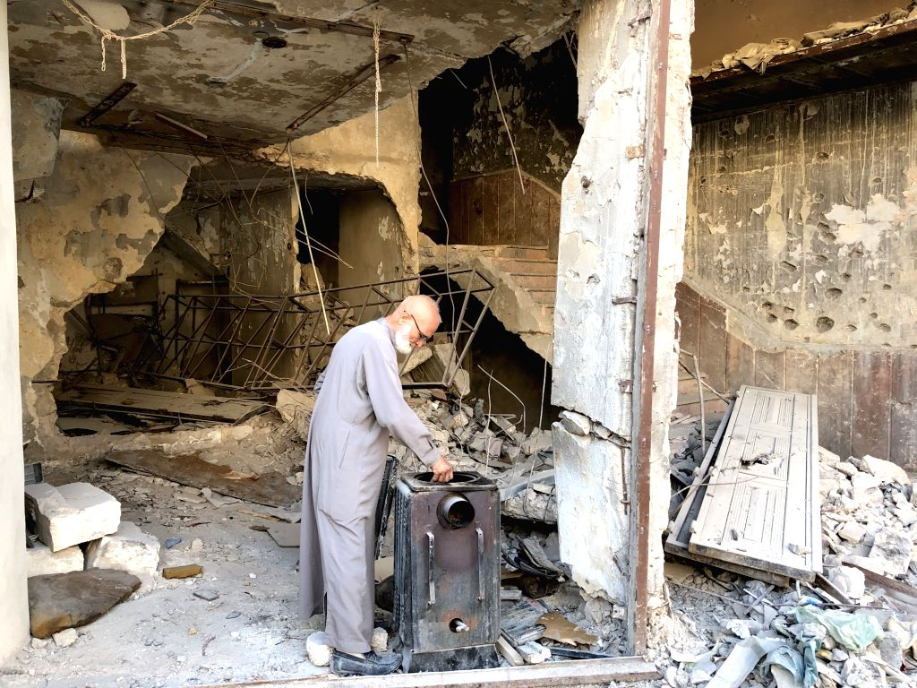 ALEPPO, Oct. 14, 2017 - Abu Subhi makes himself a cup of tea in front of his shop in Aleppo, Syria, on Oct. 12, 2017. In the ruins of the world's most historic souks, 62-year-old Abu Subhi runs a ...