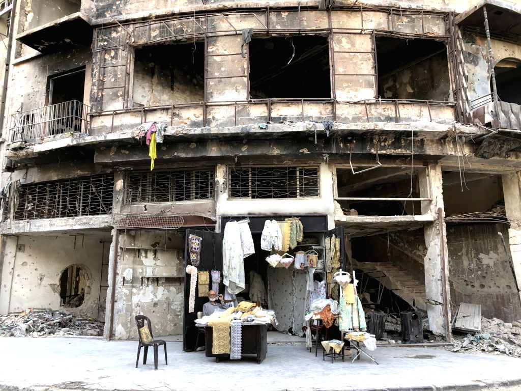 ALEPPO, Oct. 14, 2017 - Abu Subhi sits in front of his shop in Aleppo, Syria, on Oct. 12, 2017. In the ruins of the world's most historic souks, 62-year-old Abu Subhi runs a very small shop in Khan ...