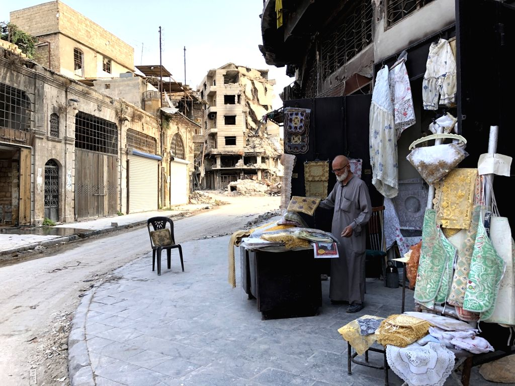 ALEPPO, Oct. 14, 2017 - Abu Subhi works in his shop in Aleppo, Syria, on Oct. 12, 2017. In the ruins of the world's most historic souks, 62-year-old Abu Subhi runs a very small shop in Khan al-Harir ...
