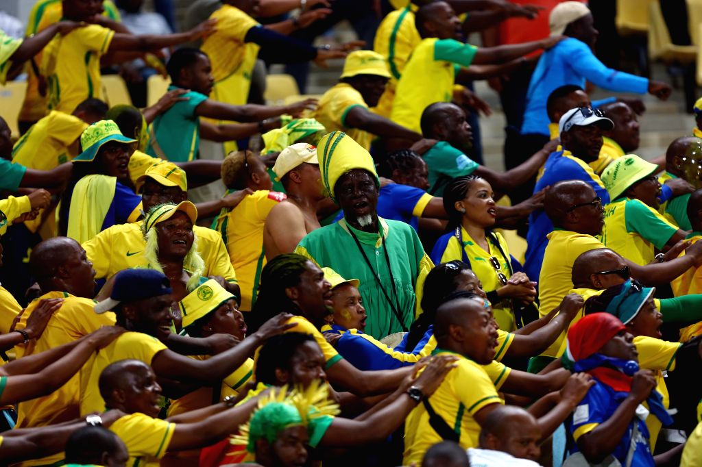 ALEXANDIA, Oct. 24, 2016 - Mamelodi Sundowns' fans cheer for their team during the 2016 African Champions League final in Alexandria, Egypt, on Oct. 23, 2016. South Africa's Mamelodi Sundowns won the ...