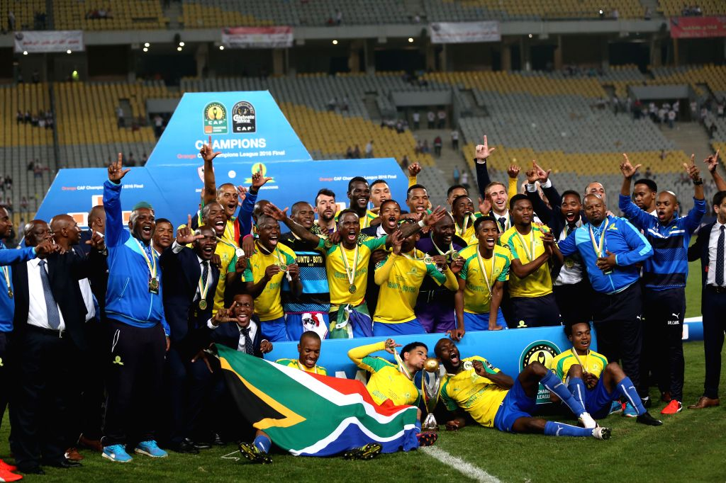 ALEXANDIA, Oct. 24, 2016 - Players of Mamelodi Sundowns celebrate after claiming the 2016 African Champions League title in Alexandria, Egypt, on Oct. 23, 2016. South Africa's Mamelodi Sundowns won ...
