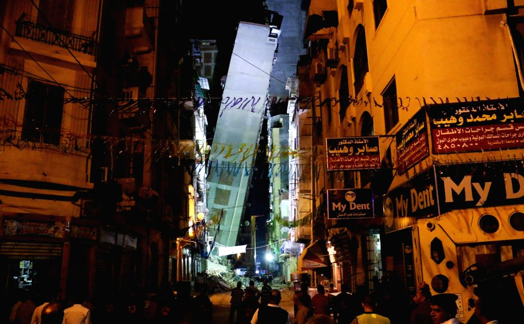 ALEXANDRIA (EGYPT), June 2, 2017 Photo taken on June 1, 2017 shows the building which toppled over and leaned on another tall building in Alexandria, Egypt. A 14-floor building toppled ...