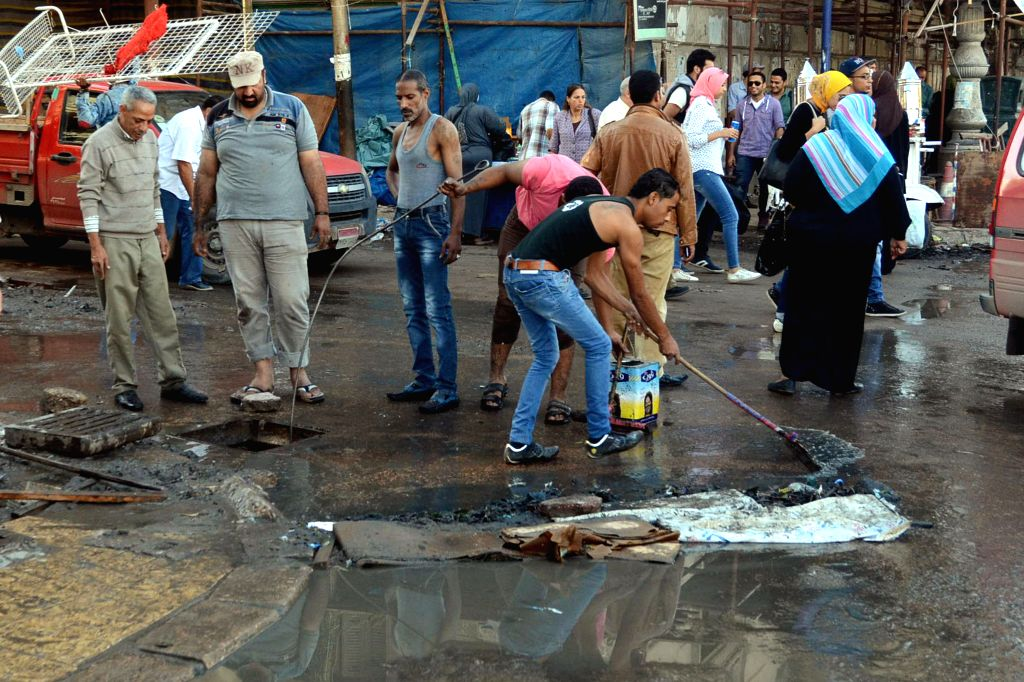ALEXANDRIA (EGYPT), Oct. 26, 2015 Egyptians clean the street after a flood caused by rainy weather in the city of Alexandria, Egypt's Mediterranean city, on Oct. 26, 2015. Seven people in ...