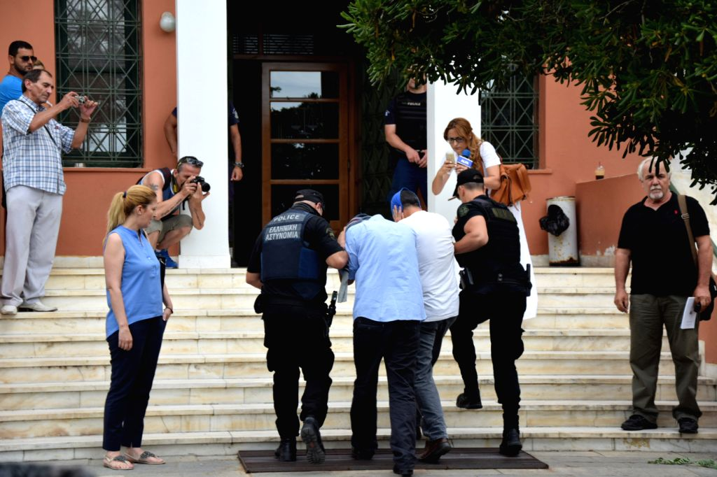 ALEXANDROUPOLIS, July 18, 2016 - Policemen escort Turkish military officers, who fled to Greece in a military helicopter on Saturday after the failed coup in Turkey, into a court in Alexandroupolis, ...