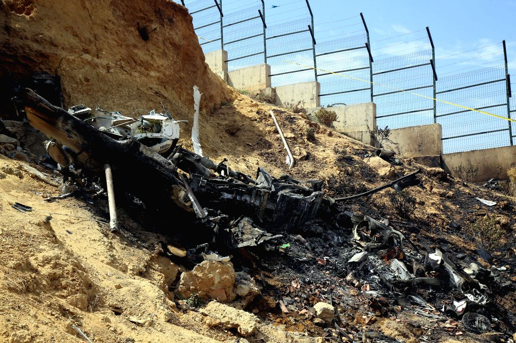 ALGIERS, Aug. 10, 2017 - Photo taken on Aug. 10, 2017 shows a helicopter crash site in in the Douira neighborhood of Algiers, Algeria. Four people died on Thursday in a helicopter crash in the Douira ...