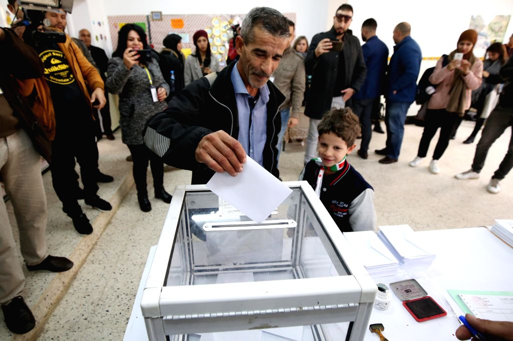 ALGIERS, Dec. 12, 2019 - A voter casts his vote at a polling station during the country's presidential election in Algiers, Algeria on Dec. 12, 2019. Polling centers were opened on Thursday in ...