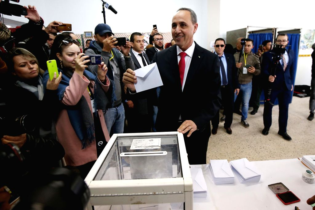 ALGIERS, Dec. 12, 2019 - Algerian presidential election candidate Azzedine Mihoubi (C) casts his vote at a polling station in Algiers, Algeria on Dec. 12, 2019. Algeria held presidential election on ...