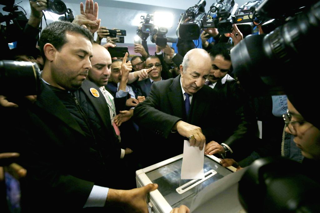ALGIERS, Dec. 12, 2019 - Algerian presidential candidate Abdelmadjid Tebboune (C) casts his vote at a polling station in Algiers, Algeria on Dec. 12, 2019. Algeria held presidential election on ...
