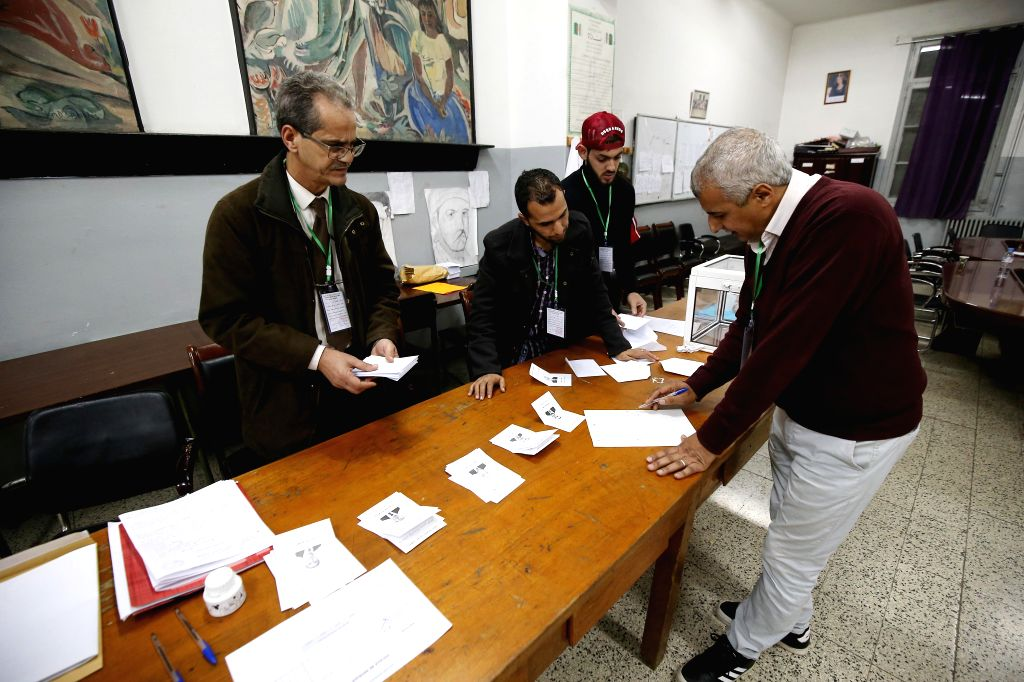 ALGIERS, Dec. 12, 2019 - Election officials count votes in Algiers, Algeria, on Dec. 12, 2019. Algeria held presidential election on Thursday. A total of five candidates are running for the ...