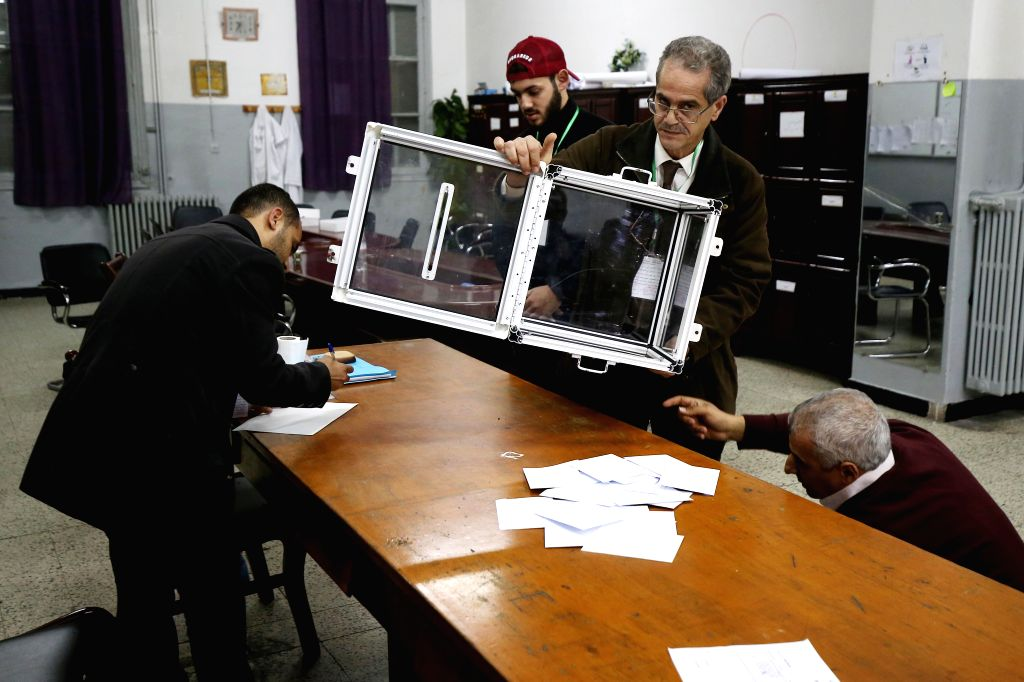 ALGIERS, Dec. 12, 2019 - Election officials empty a ballot box in Algiers, Algeria, on Dec. 12, 2019. Algeria held presidential election on Thursday. A total of five candidates are running for the ...