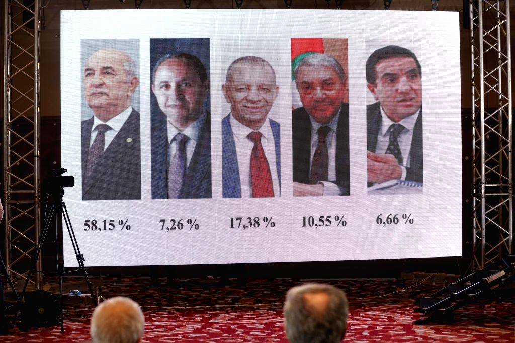 ALGIERS, Dec. 13, 2019 - The percentage of votes of the five presidential candidates is shown during a press conference in Algiers, Algeria, Dec. 13, 2019. Abdelmadjid Tebboune has been elected the ...