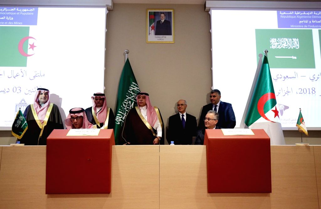 ALGIERS, Dec. 3, 2018 - Saudi Minister of Commerce and Investment Majid bin Abdullah al Qassabi (4th L) and Algerian Minister of Industry and Mines Youcef Yousfi (3rd R) attend the 12th ...
