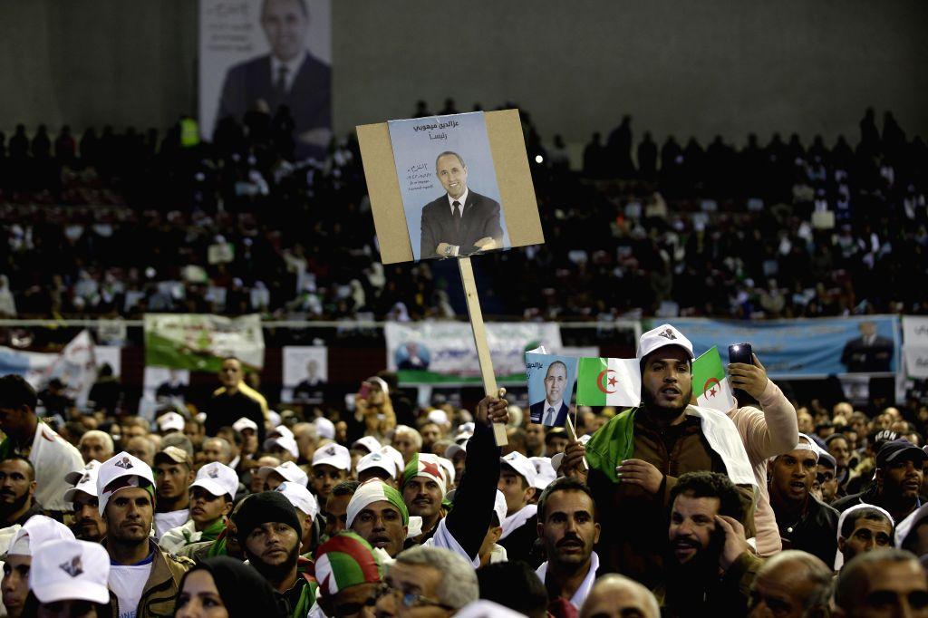 ALGIERS, Dec. 5, 2019 - Supporters participates in an election campaign of presidential candidate Azzedine Mihoubi in Algiers, Algeria on Dec. 4, 2019. Algeria will hold presidential election on Dec. ...