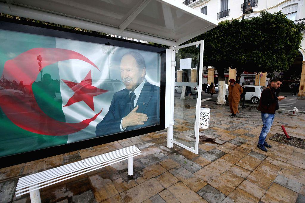 ALGIERS, Feb. 11, 2019 - A banner of a portrait of Algerian President Abdelaziz Bouteflika and the Algerian national flag is seen on a street in Algiers, Algeria, Feb. 11, 2019. Algerian President ...