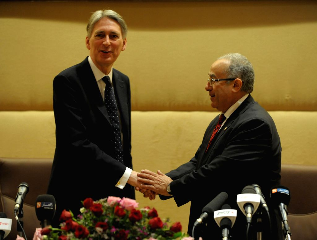 British Foreign Minister Philip Hammond shakes hands with Algerian Foreign Minister Ramtane Lamamra (R) during a joint press conference following a meeting in ... - Philip Hammond