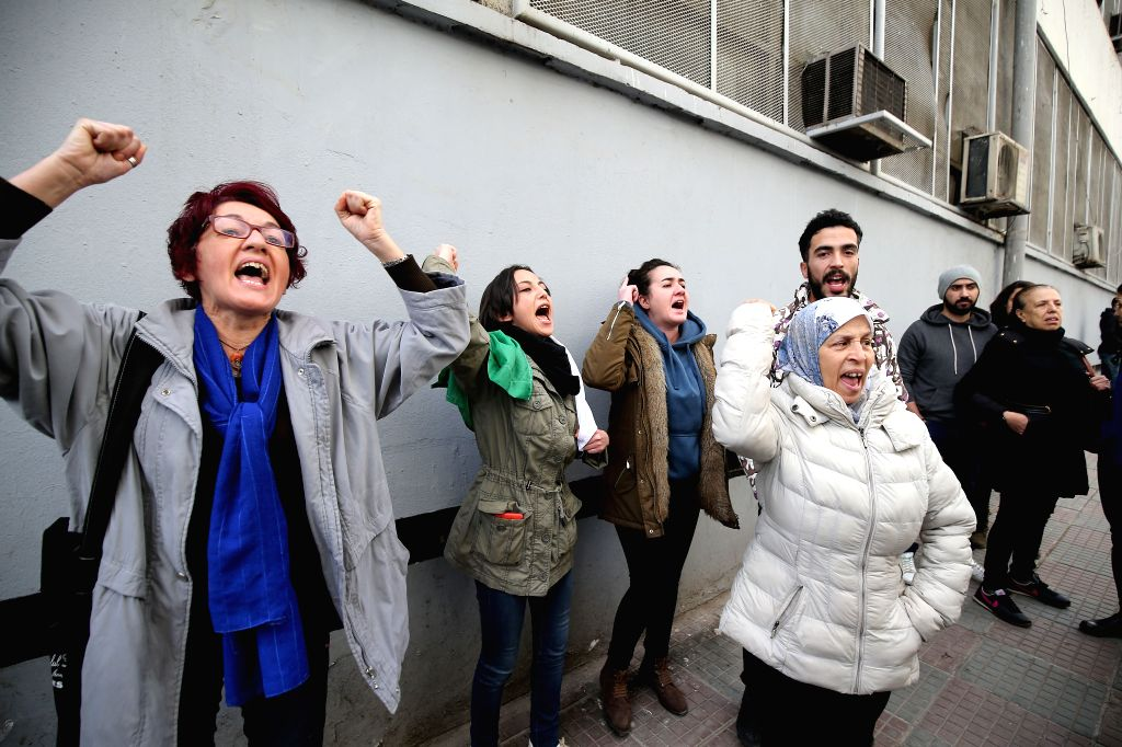 ALGIERS, Feb. 22, 2019 - People shout slogans during a protest against the decision of incumbent President Abdelaziz Bouteflika to seek a fifth term in Algiers, Algeria, Feb. 22, 2019. Tens of ...