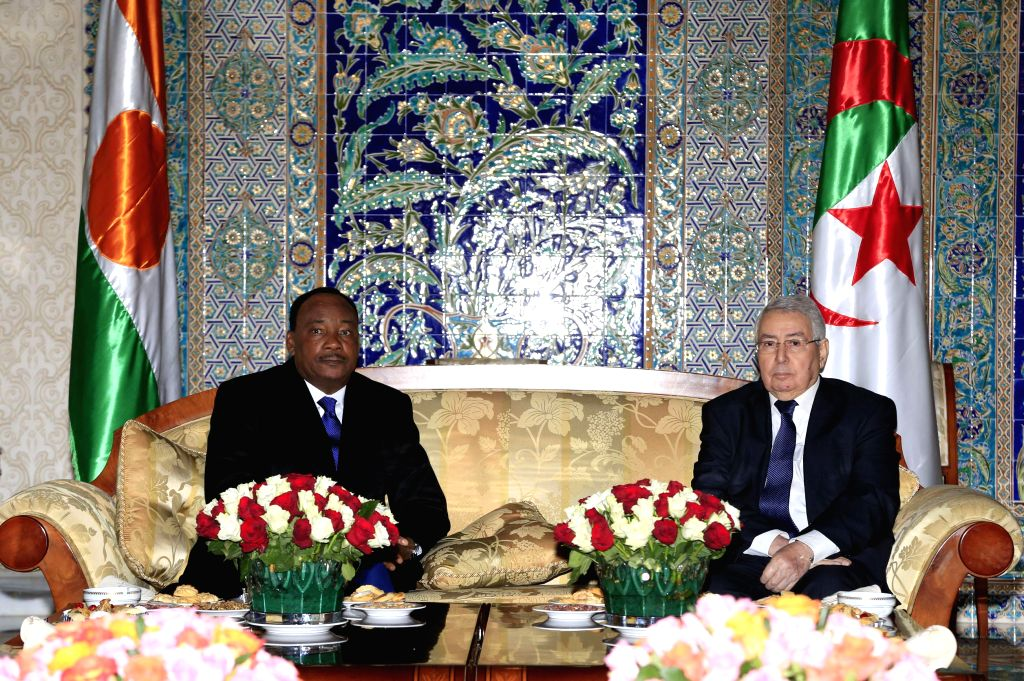 Abdelkader Bensalah (R), the upper parliament house speaker of Algeria, meets with Nigerien President Mahamadou Issoufou in Algiers, Algeria, Jan. 25, 2015. ...