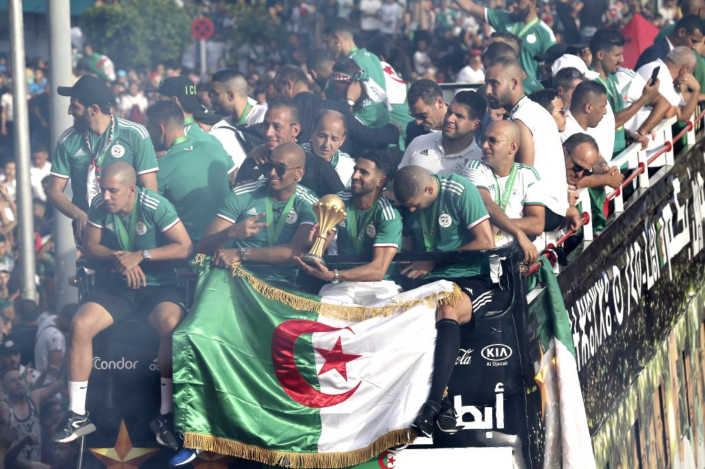 ALGIERS, July 21, 2019 - Algeria football national team celebrate with fans in downtown Algiers, Algeria, July 19, 2019. Algeria beat Senegal in Africa's Cup of Nations final by 1-0 and claimed the ...
