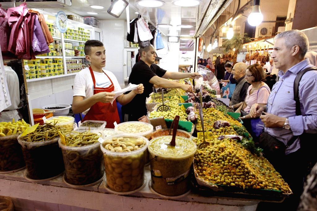 ALGIERS, June 1, 2017 - People buy olives during the holy month of Ramadan in Algiers, Algeria, May 31, 2017.