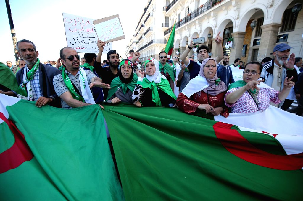 ALGIERS, May 31, 2019 - Algerians demonstrate in the main streets of Algiers, Algeria, on May 31, 2019. Algerians staged protests on Friday to ask for postponing the presidential election that will ...