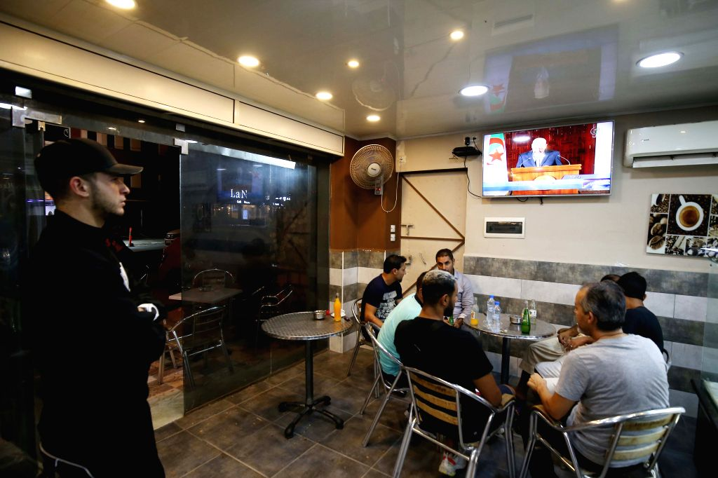 ALGIERS, Sept. 15, 2019 - People watch a live speech broadcast of Algerian interim President Abdelkader Bensalah in Algiers, Algeria, on Sept. 15, 2019. Abdelkader Bensalah on Sunday announced that ...