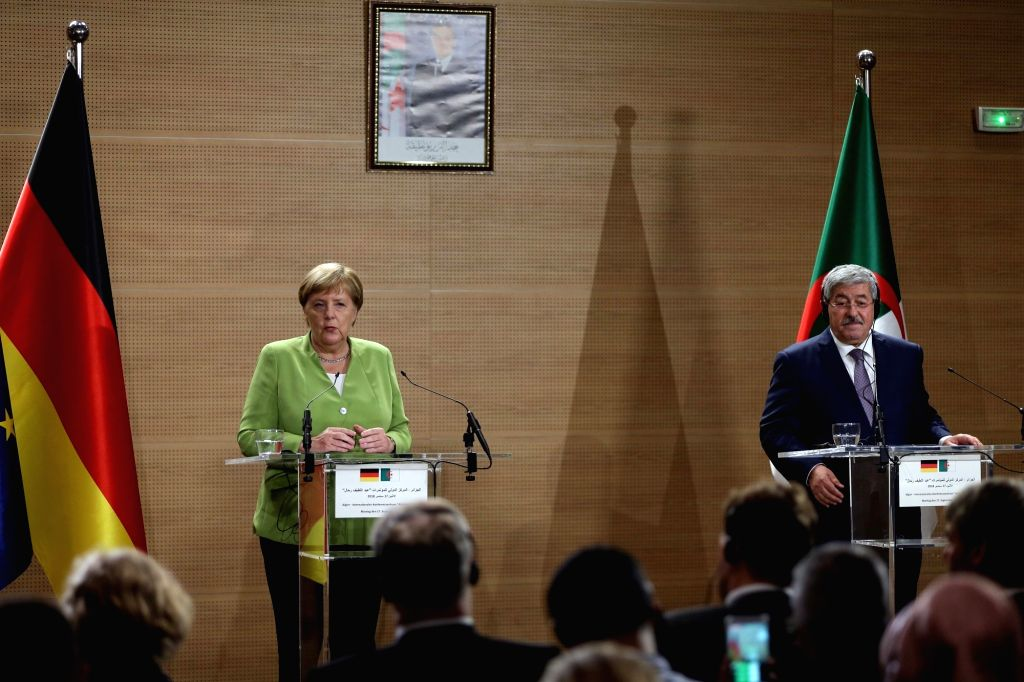 ALGIERS, Sept. 17, 2018 - German Chancellor Angela Merkel (L, Rear) and Algerian Prime Minister Ahmed Ouyahia (R, Rear) attend a joint press conference in Algiers, Algeria, on Sept. 17, 2018. German ... - Ahmed Ouyahia
