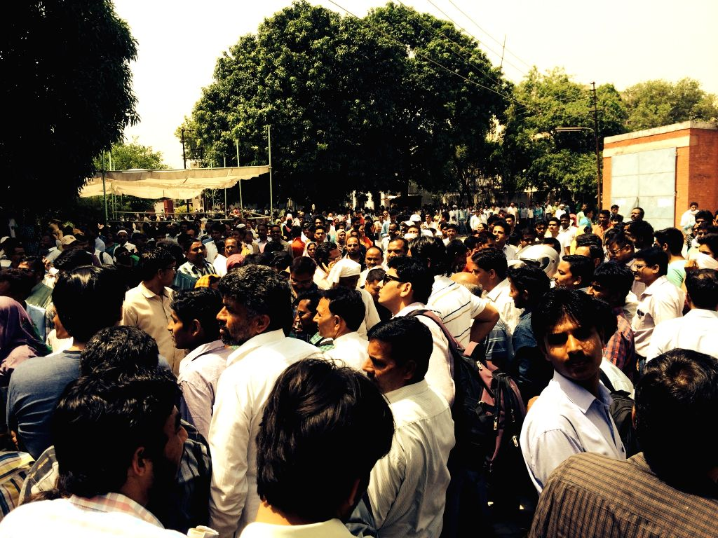Guardians of students appearing for MBBS/BDS entrance exam wait for their wards outside exam halls at Aligarh Muslim University, on April 26, 2015.