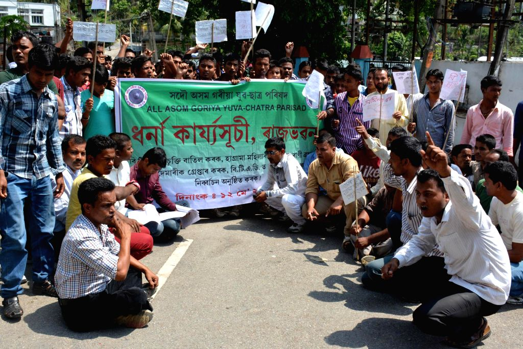 All Asom Goriya Yuva-Chatra Parishad (AAGYCP) activists demonstrate against recent BTAD violence near Raj Bhawan in Guwahati on May 12, 2014.