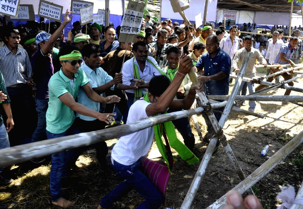 All Assam Barman Kachari Student's Union (AABKSU) activists break barricades as they demonstrate to press for their demands in Guwahati on on Aug 7, 2014.