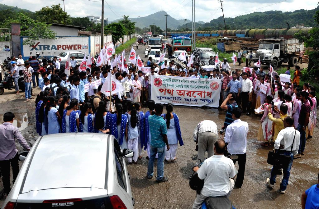 All Assam Student's Union (AASU) activists block Noonmati road to protest against poor condition of roads in Guwahati on Sept 9, 2014.