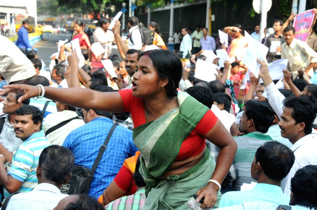 All Bengal Chit Fund Depositors and Agents Forum stage a demonstration to press for their demands in front of Raj Bhavan in Kolkata, on March 29, 2016.