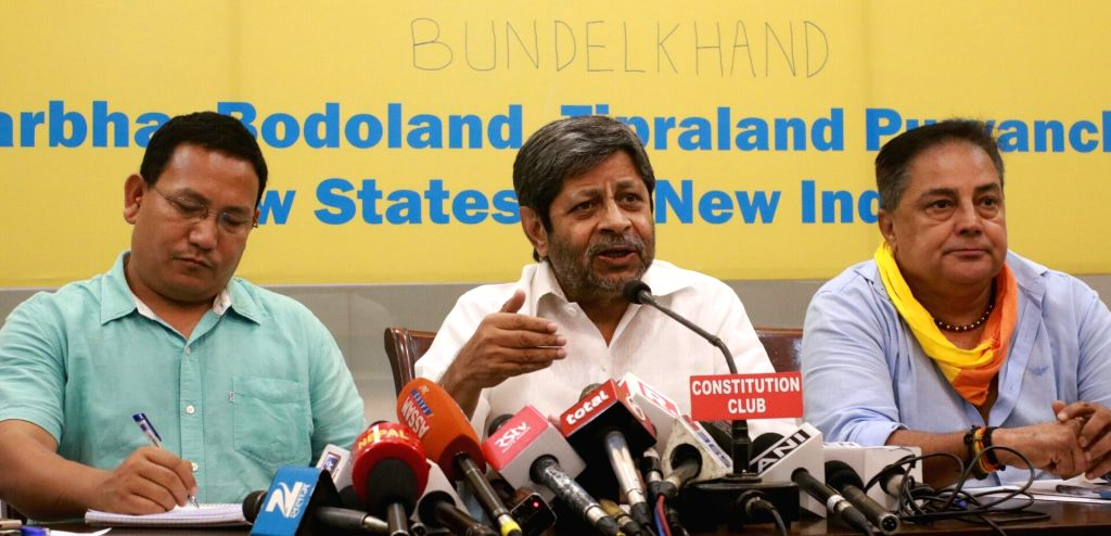 All Bodo Students Union (ABSU) president Pramod Boro, National Federation of New States (NFNS) president Shrihari Aney and Bundelkhand Mukti Morcha president Raja Bundela during a press ...