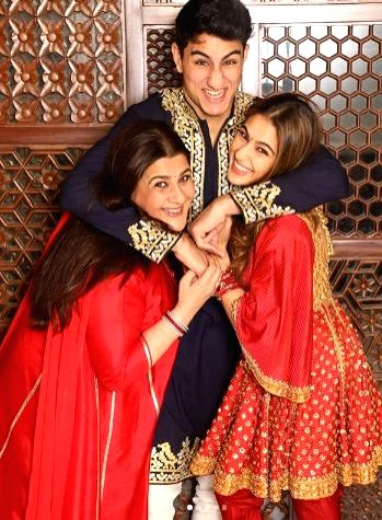All dressed up and looking gorgeous in stunning ensembles, Bollywood stars like Amitabh Bachchan, Karan Johar, Shah Rukh Khan and Sara Ali Khan among many others celebrated the festival of lights with their near and dear ones. - Karan Johar, Amitabh Bachchan, Rukh Khan and Sara Ali Khan
