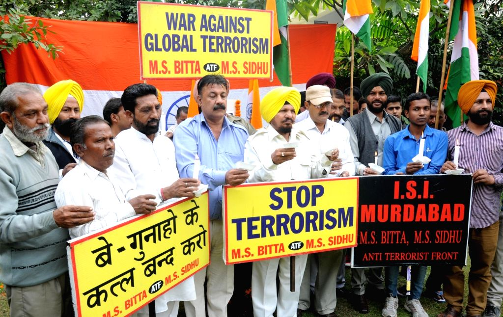 All-India Anti-Terrorist Front (AIATF) members hold a candlelight vigil to pay tribute to the victims of Paris terror attacks in Amritsar on Nov 15, 2015.