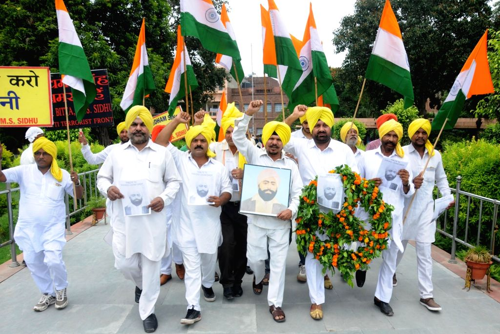 All India Anti Terrorist front Punjab Senior Vice President MS Sidhu and activist of AIATF pay tribute to Indian Freedom Fighter Shaheed Udham Singh on the eve of his 76th martyrdom day at ...