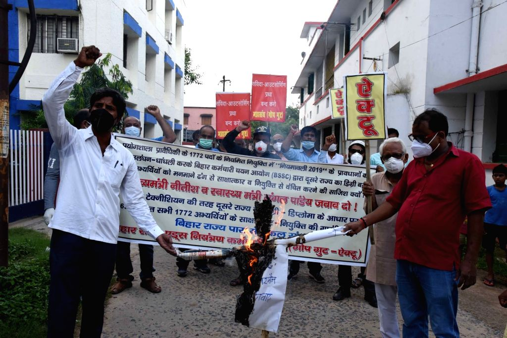 All India Central Council of Trade Unions (AICCTU) activists stage a demonstration against Bihar Chief Minister Nitish Kumar and Health Minister Mangal Pandey over alleged corruption in the ... - Nitish Kumar and Mangal Pandey