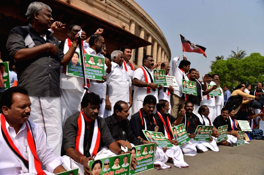 All India Dravida Munnetra Kazhagam (AIADMK) MPs stage a demonstration at Parliament in New Delhi on April 3, 2018.