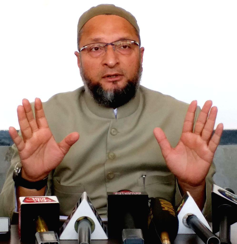 All India Majlis-e-Ittehad-ul Muslimeen (AIMIM) President Asaduddin Owaisi talks to media persons in Hyderabad, on March 14, 2019.