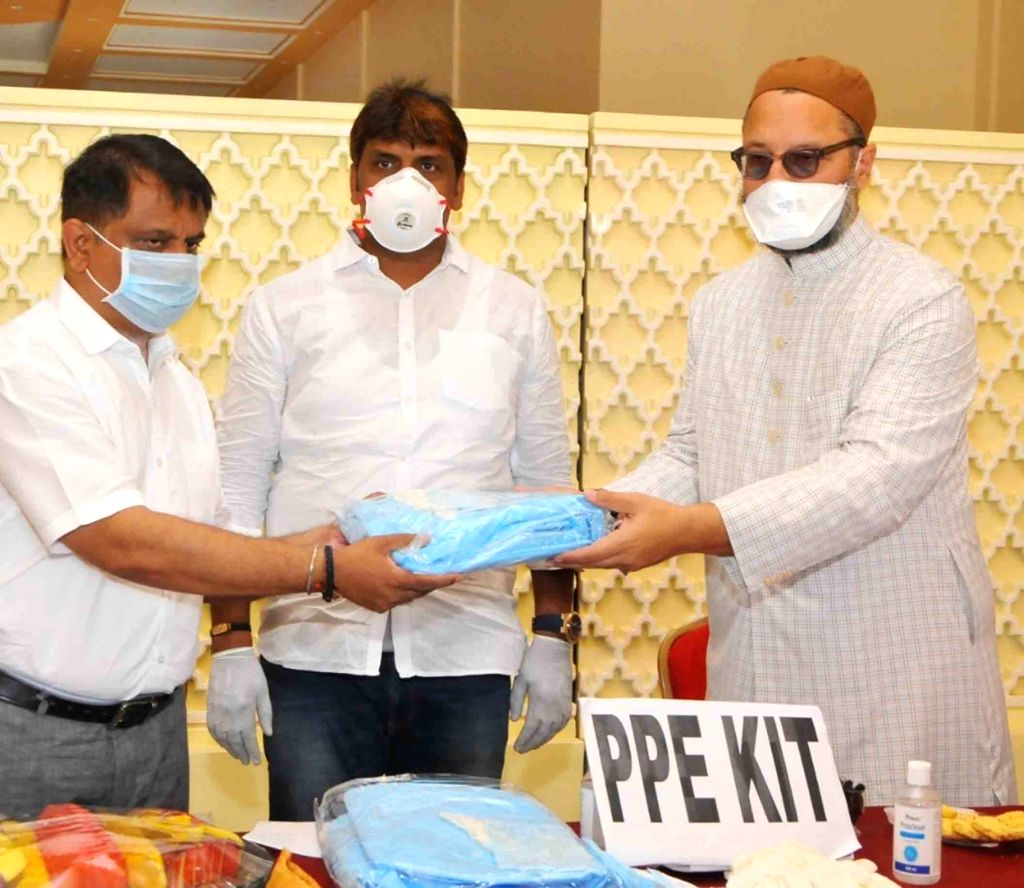 All India Majlis-e-Ittehadul Muslimeen (AIMIM) President and Hyderabad MP Asaduddin Owaisi distributes Personal Protection Equipment (PPE Kits) among Asha, Anganwadi workers and police ...