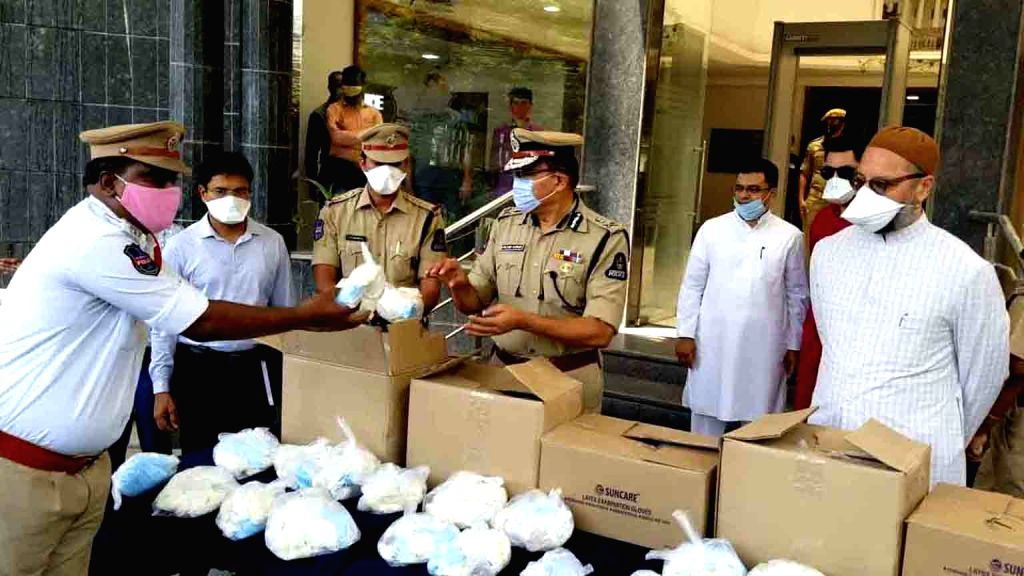 All India Majlis-e-Ittehadul Muslimeen (AIMIM) President and Hyderabad MP Asaduddin Owaisi with Hyderabad Police Commissioner Anjani Kumar at the distribution of Personal Protection Equipment (PPE ...