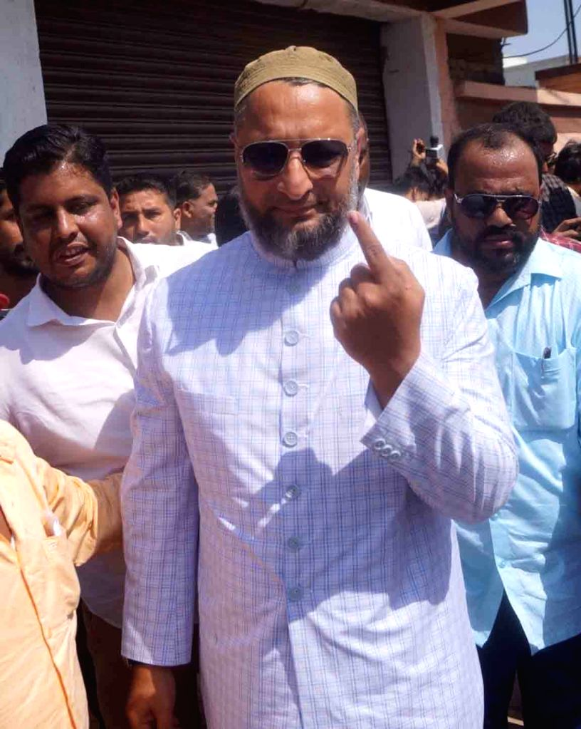 All India Majlis-e-Ittehadul Muslimeen (AIMIM) President Asaduddin Owaisi, who is contesting for a fourth consecutive term from Hyderabad constituency, shows his inked finger after casting ...